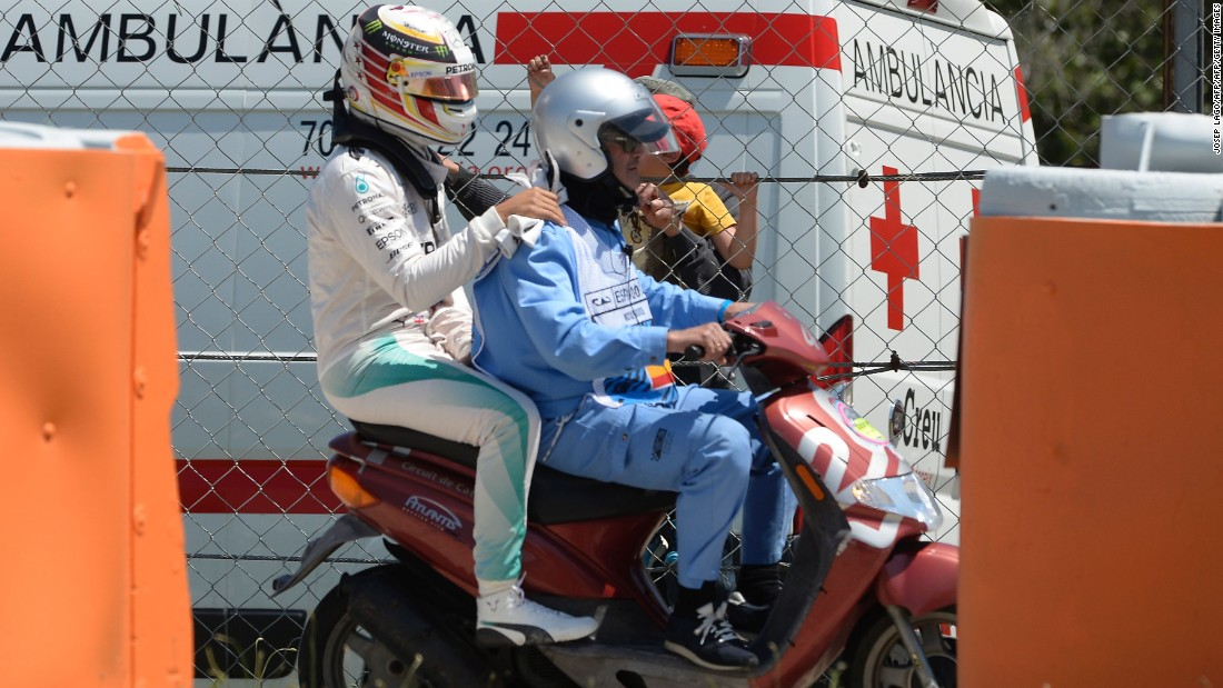 Hamilton swapped four wheels for two, as he was escorted back to Mercedes' base on a scooter following the crash.