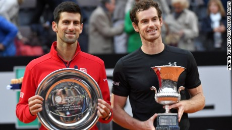 Andy Murray and Novak Djokovic pose with their trophies following the Scot's victory in the Italian Open final