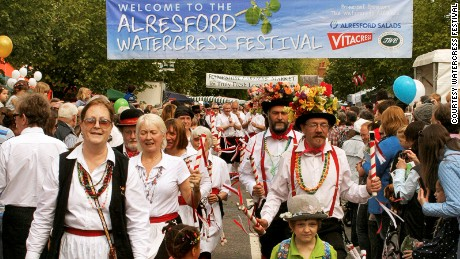 Morris dancers herald the approach of the Watercress King and Queen.