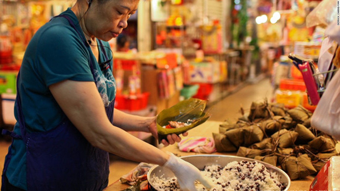 Zongzi dumplings consumed on this day in June consist of glutinous rice with varied fillings.