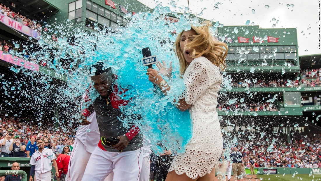 "TV reporter Guerin Austin is an unlucky bystander as David Ortiz is doused by his Boston teammates on Saturday, May 14. Ortiz had just won a game with a base hit. Austin was <a href=""https://twitter.com/guerinaustin/status/731925964687572992"" target=""_blank"">good-natured about the incident on Twitter</a> and wore a light-blue raincoat the next day."