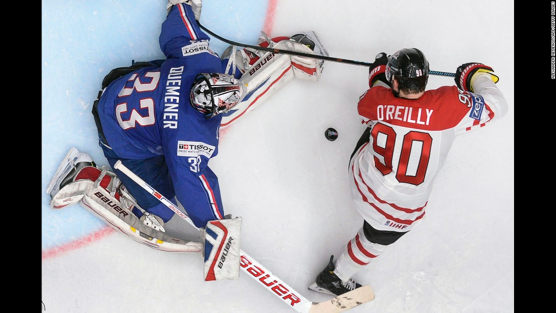 Canada's Ryan O'Reilly tries to play the puck in front of French goalie Ronan Quemener during a game at the World Championships on Monday, May 16. The tournament is taking place in St. Petersburg, Russia.