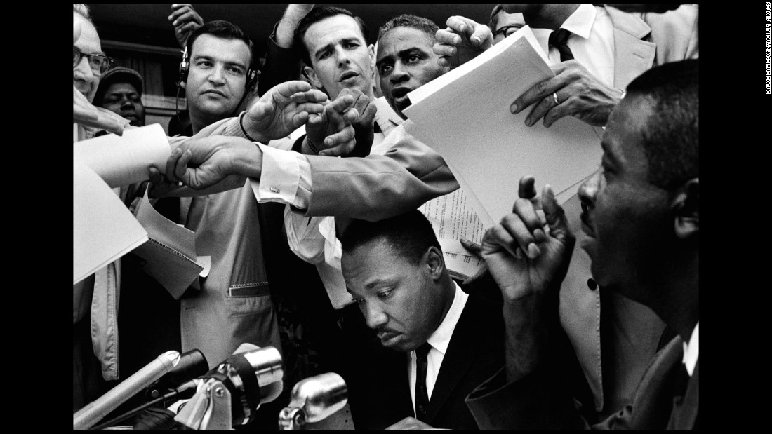 The Rev. Martin Luther King Jr. is surrounded at a news conference in Birmingham, Alabama, in 1962.
