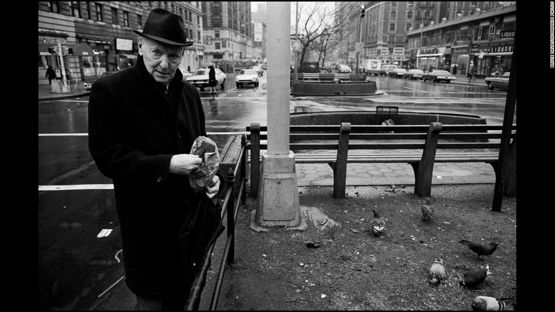 Isaac Bashevis Singer, an author who won the Nobel Prize in Literature in 1978, feeds birds in New York in 1975.