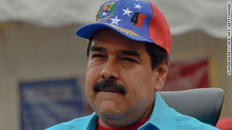 "Venezuelan President Nicolas Maduro at a rally in Caracas on May 14, 2016.  Venezuela braced for protests Saturday after President Nicolas Maduro declared a state of emergency to combat the ""foreign aggression"" he blamed for an economic crisis that has pushed the country to the brink of collapse. / AFP / JUAN BARRETO        (Photo credit should read JUAN BARRETO/AFP/Getty Images)"