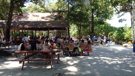 Tourists eat lunch at a picnic area on Koh Tachai.