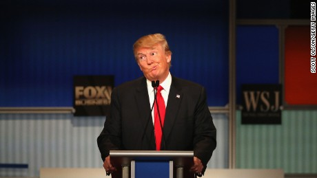 MILWAUKEE, WI - NOVEMBER 10:  Presidential candidate Donald Trump gestures after Carly Fiorina says she met with Russian President Putin at a one on one meeting, during the Republican Presidential Debate sponsored by Fox Business and the Wall Street Journal at the Milwaukee Theatre November 10, 2015 in Milwaukee, Wisconsin. The fourth Republican debate is held in two parts, one main debate for the top eight candidates, and another for four other candidates lower in the current polls.  (Photo by Scott Olson/Getty Images)