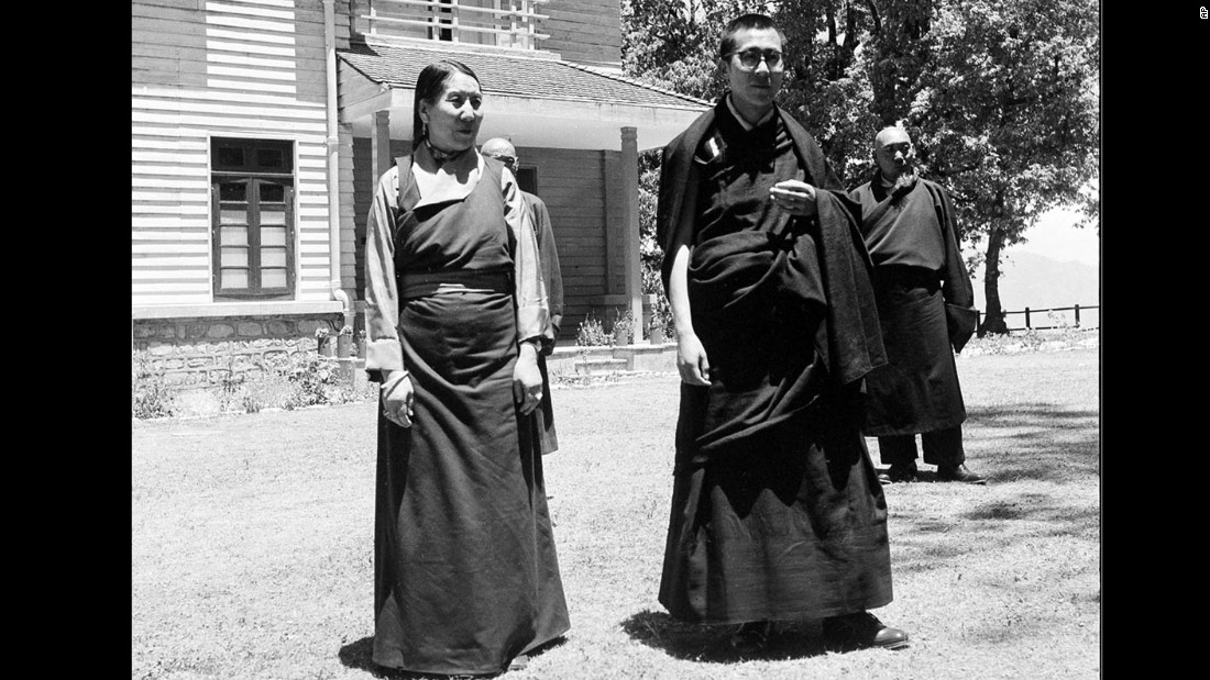 The Dalai Lama is seen with his mother outside the Birla House, his residence in Mussoorie. In 1960 he moved to Dharamsala, India, which remains his home today.