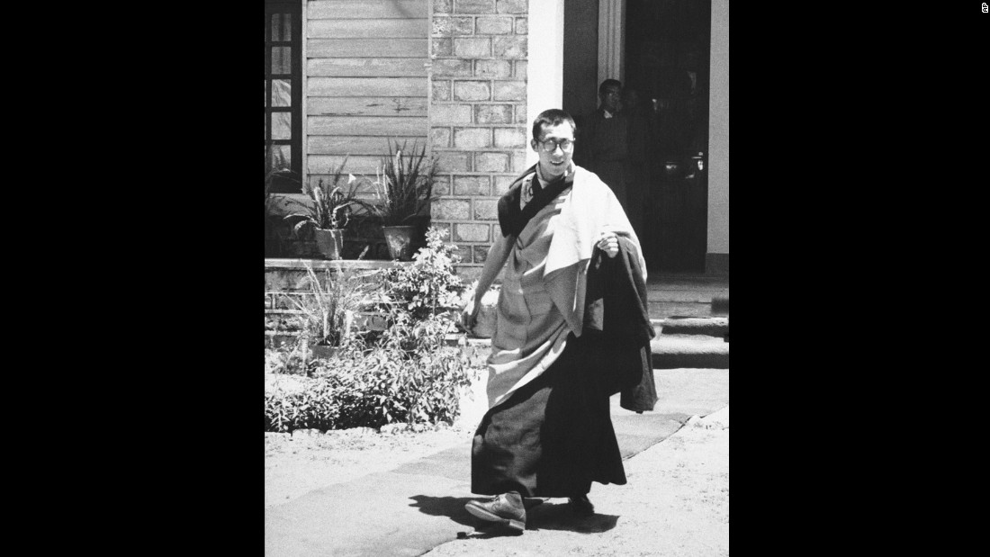 The Dalai Lama comes out of his house to address a religious congregation on May 22, 1959. He was 24 years old.