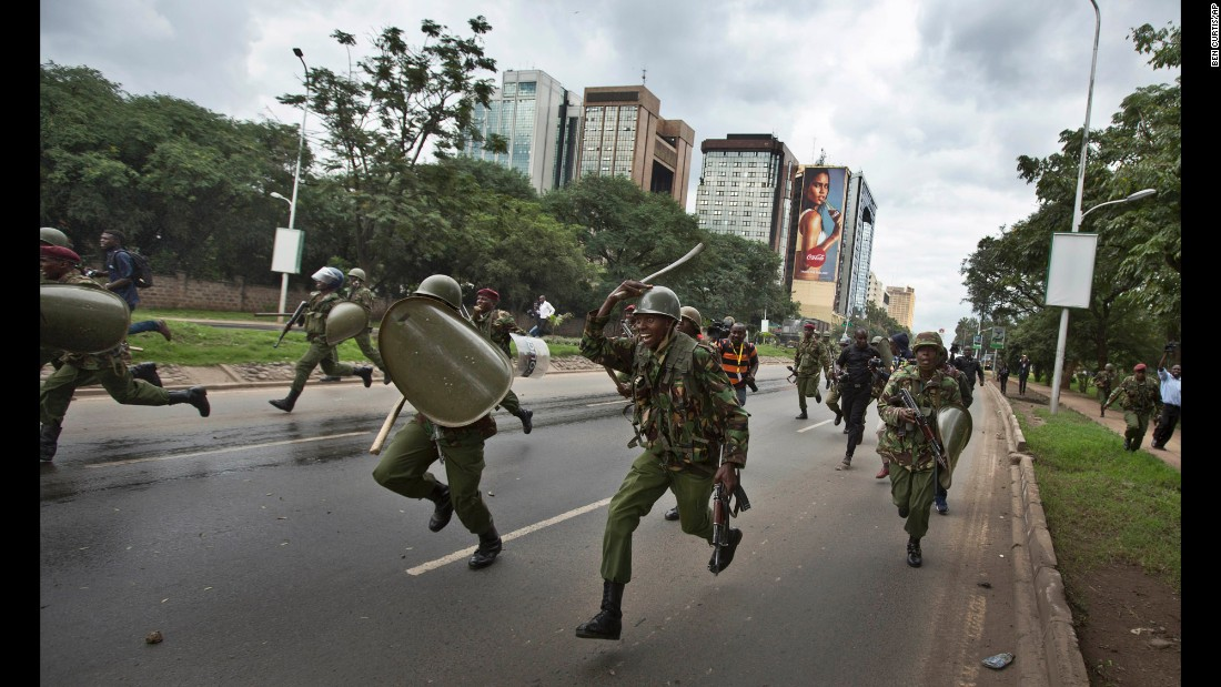 Riot police charge toward opposition supporters during a protest in Nairobi, Kenya, on Monday, May 9.