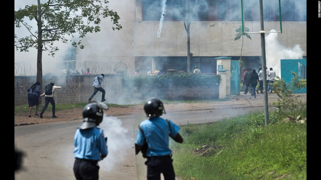 "Police fire tear gas toward opposition supporters as they run away on May 9. ""Having covered the previous protests we were expecting it to end in tear gas and rock-throwing, but not necessarily the kind of violence that we witnessed on Monday,"" Curtis said."