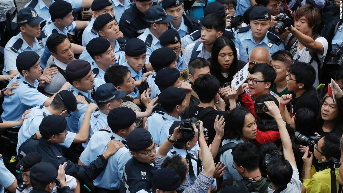 Hong Kong police clash with anti-Beijing protesters who took to the streets during the three-day visit of senior Chinese official Zhang Dejiang on Wednesday, May 18, 2016.