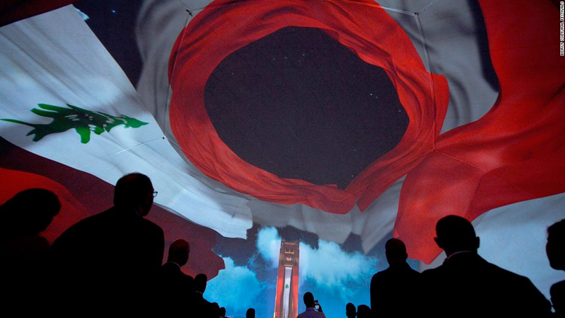 The Lebanese flag swirls on the roof of the dome as the audience rises proudly for the national anthem to mark the country's 1943 independence.