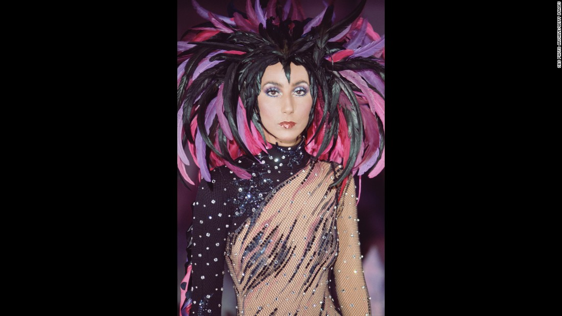 "Throughout her career, Cher has always been known for her flamboyant fashion. Here, she wears a feathered headdress for ""The Sonny and Cher Comedy Hour"" in 1972."