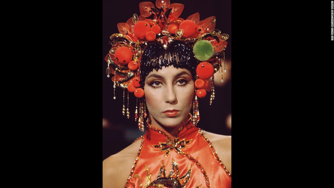 Cher wears an Asian-styled headdress and a sleeveless satin top for her show in 1972.