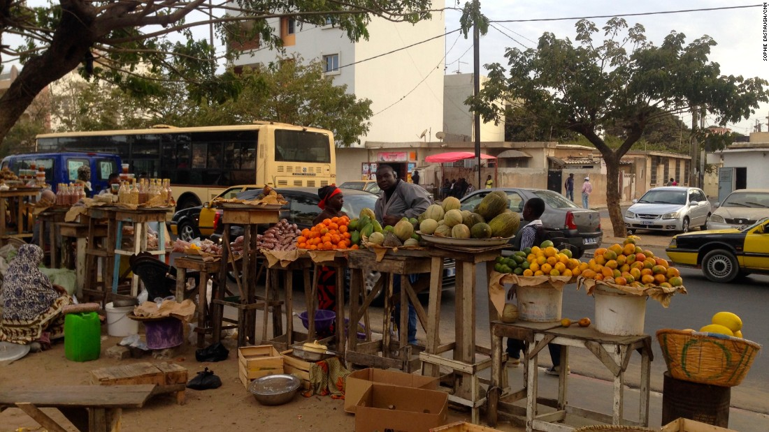 Back in the capital, the hustle of commerce extends to Dakar's sidewalks.