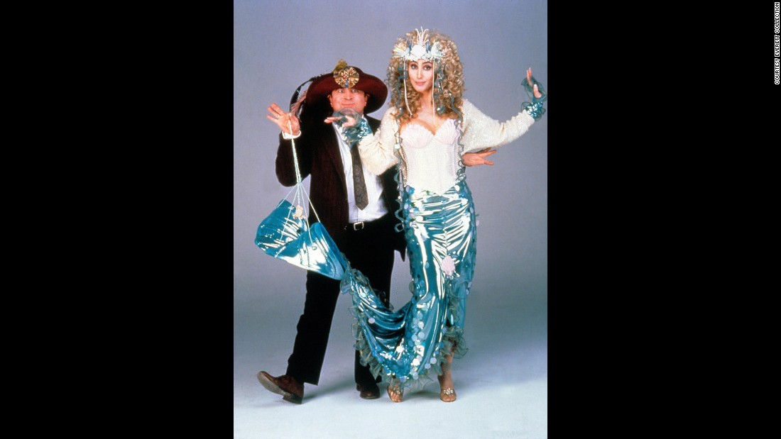 "Cher poses with actor Bob Hoskins to promote their 1990 film ""Mermaids."""