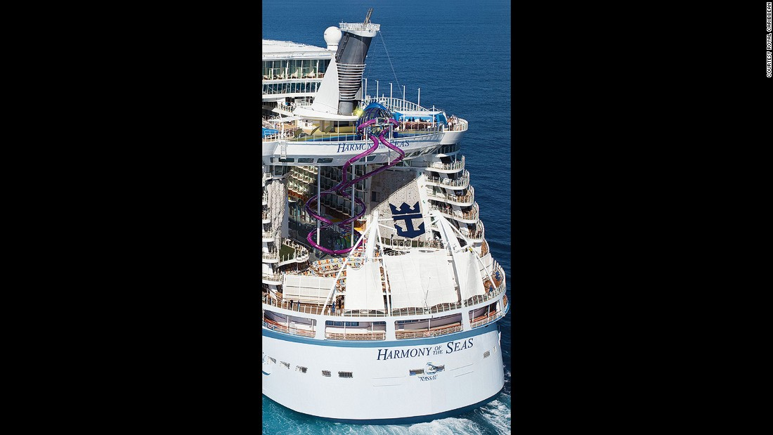 "See those purple, squiggly things in the back of the ship? That's one of Harmony's biggest attractions: The Ultimate Abyss, which the cruise line calls ""the tallest slide on the high seas."" It takes guests on a 100-foot drop from Deck 16 to Deck 6."
