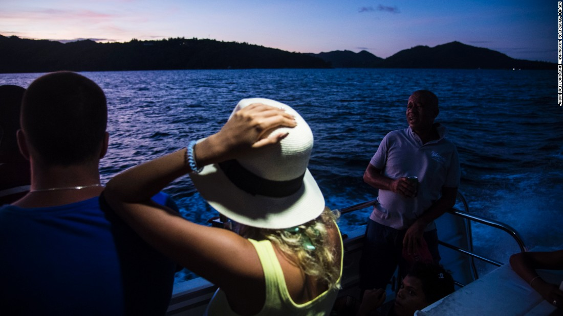 "Ferry passengers watch the sun set as they leave the island of Praslin in the Seychelles. Praslin's <a href=""/2016/02/17/travel/tripadvisor-best-beaches-world-feat/index.html"" target=""_blank"">Anse Lazio</a> was recently named the fourth-best beach in the world by TripAdvisor."