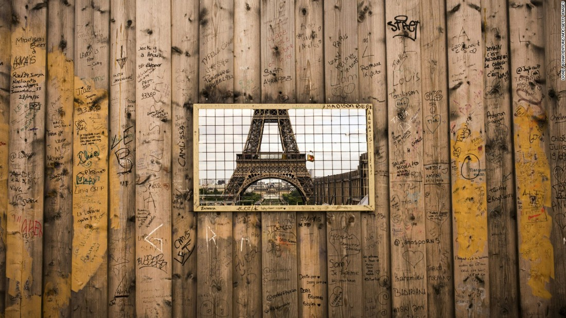 "The Eiffel Tower is seen through a grille in wooden panels surrounding a construction site. The iconic tourist attraction finished in 14th place in TripAdvisor's 2016 list of the world's <a href=""/2016/05/17/travel/tripadvisor-top-world-landmarks/index.html"" target=""_blank"">most-beloved landmarks.</a>"