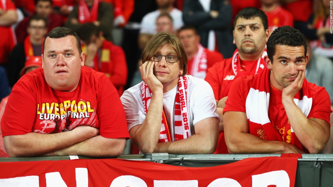 Liverpool supporters appear dejected during the match.