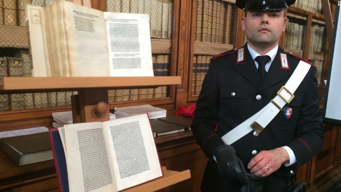 An Italian security officer in Rome stands with a rare copy of a letter written by Christopher Columbus in 1493 to King Ferdinand and Queen Isabella of Spain. The letter apparently was stolen from a Florence museum more than 65 years ago.