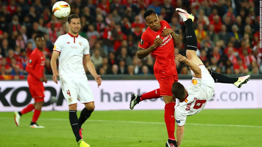 Gameiro goes close for Sevilla with a bicycle kick.
