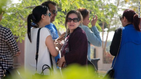 Relatives of passengers on a vanished EgyptAir flight grieve as they leave the in-flight service building where they were held at Cairo International Airport, Egypt, Thursday, May 19, 2016. Egyptian aviation officials say an EgyptAir flight from Paris to Cairo with 66 passengers and crew on board has crashed. The officials say the search is now underway for the debris. (AP Photo/Amr Nabil)