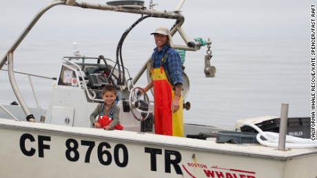 Fisherman Calder Deyerle and his son Miles helped save the ensnared humpback whale by alerting rescue teams