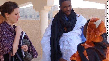 Maitre Mohameden Elid, center, and Sarah Mathewson, left, helped bring a successful slavery case to court in Mauritania, according to Anti-Slavery International. They are pictured with a victim of slavery who was not involved in that case.