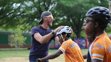 CNN Hero Craig Dodson and cyclist Devonte, 17