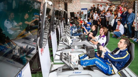 Formula E drivers race against the public on simulators before the real action gets underway.