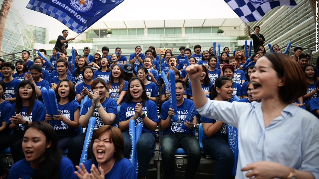 Leicester fans run through a cheerleading routine as they prepare to welcome the victorious Foxes players and staff to the city. Some of Bangkok's major roads were closed to traffic for the parade, which centered on Sukhumvit Road, a street that crosses the city.