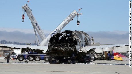 SAN FRANCISCO, CA - JULY 12:  The wrecked fuselage of Asiana Airlines flght 214 sits in a storage area at San Francisco International Airport on July 12, 2013 in San Francisco, California. Nearly one week after Asiana Airlines flight 214 crash landed at San Francisco International Airport, the wrecked fuselage was moved from the runway. Two people died in the crash and hundreds were injured.  (Photo by Justin Sullivan/Getty Images)