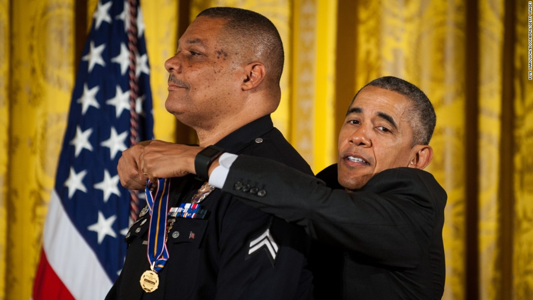 U.S. President Barack Obama awards the Medal of Valor to Los Angeles police officer Donald Thompson on Monday, May 16. While off duty, Thompson pulled a man from a car moments before it was engulfed in flames. Thompson suffered first- and second-degree burns.