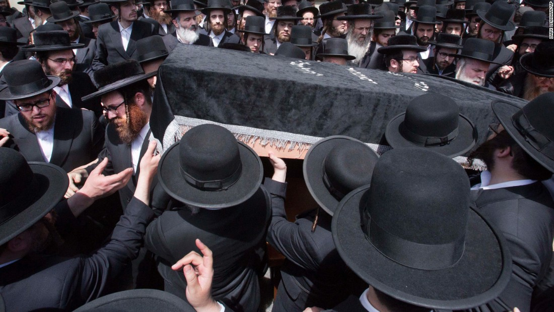 "Mourners carry the coffin of Isaac Rosenberg, a leader of the Satmar Hasidic congregation, following his funeral in New York on Wednesday, May 18. Rosenberg and another rabbi, Chaim Parnes, drowned after getting caught in a rip current in Miami, <a href=""http://www.miamiherald.com/news/local/community/miami-dade/article78134277.html"" target=""_blank"">according to the Miami Herald.</a> Rosenberg was 67 and Parnes was 66."