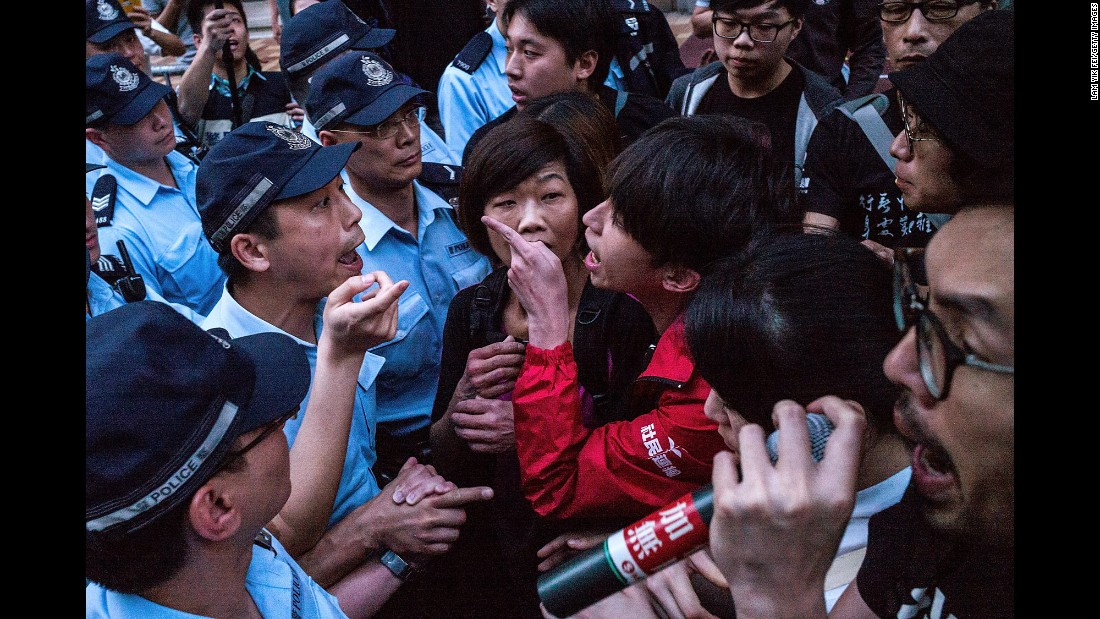 """Activists <a href=""""http://www.cnn.com/2016/05/17/china/hong-kong-protests-beijing-official-visit/"""" target=""""_blank"""">clash with police in Hong Kong</a> as Zhang Dejiang, the chairman of China's top decision-making body, arrived in the city on Wednesday, May 18. His visit comes amid a backdrop of political tension between the former British colony -- which was returned to China in 1997 -- and the central Beijing government."""