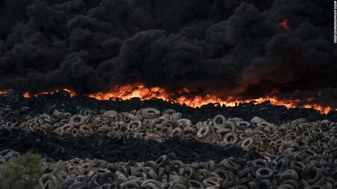 Tires burn at a dump near the Spanish town of Sesena on Friday, May 13. Officials worried that the toxic fumes could harm nearby residents, and areas were evacuated.