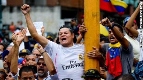 People protest against new emergency powers decreed this week by President Nicolas Maduro in Caracas on May 18, 2016. Public outrage was expected to spill onto the streets of Venezuela Wednesday, with planned nationwide protests marking a new low point in Maduro's unpopular rule. / AFP / FEDERICO PARRA        (Photo credit should read FEDERICO PARRA/AFP/Getty Images)