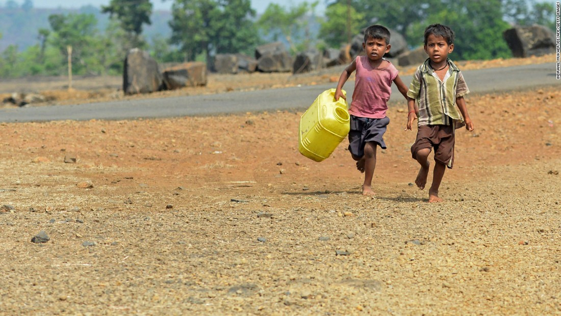 Children run with containers toward a well in Shahapur, India, on Friday, May 13.