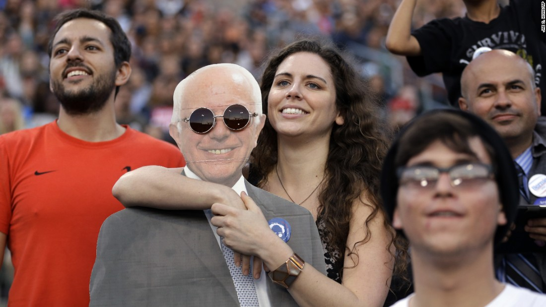 A young woman holds a cardboard cutout of U.S. Sen. Bernie Sanders during the presidential candidate's rally in Carson, California, on Tuesday, May 17.