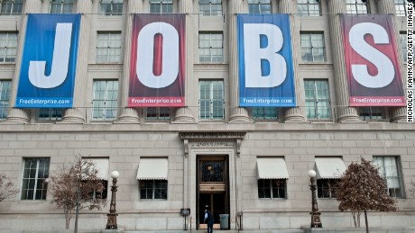 "A banner reading ""Jobs"" hangs on thre facade of the US Chamber of Commerce in Washington,DC on February 22, 2011. New claims for US unemployment insurance rose for the first time in three weeks but continued to hover near a two-year low, official data released on February 17 showed. The Labor Department said a seasonally adjusted 410,000 initial jobless claims were filed in the week ending February 12, up 6.5 percent from the prior week when claims had fallen to their lowest level since July 2008,"