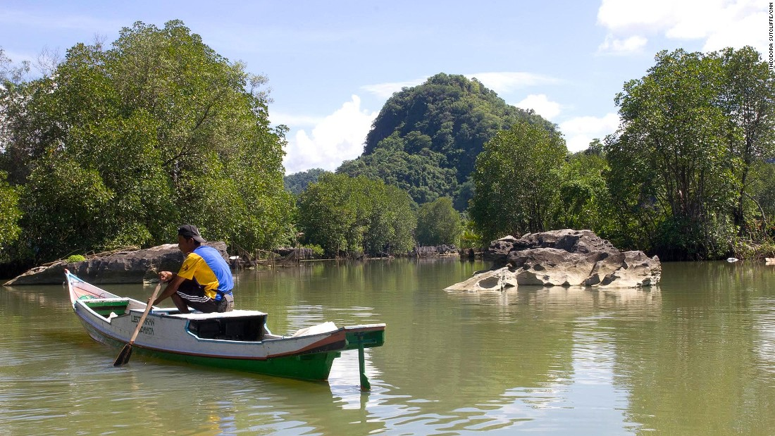 A boatman awaits passengers in Rammang-Rammang.