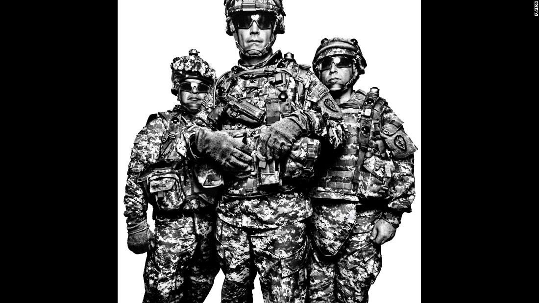 "The portraits in the book ""Service"" focus on U.S. military members and their families. From left are three members of the U.S. Army's 1st Stryker Brigade Combat Team in 2008: Command Sgt. Maj. Gabriel Cervantes, Col. Burt Thompson and interpreter John Mardo."