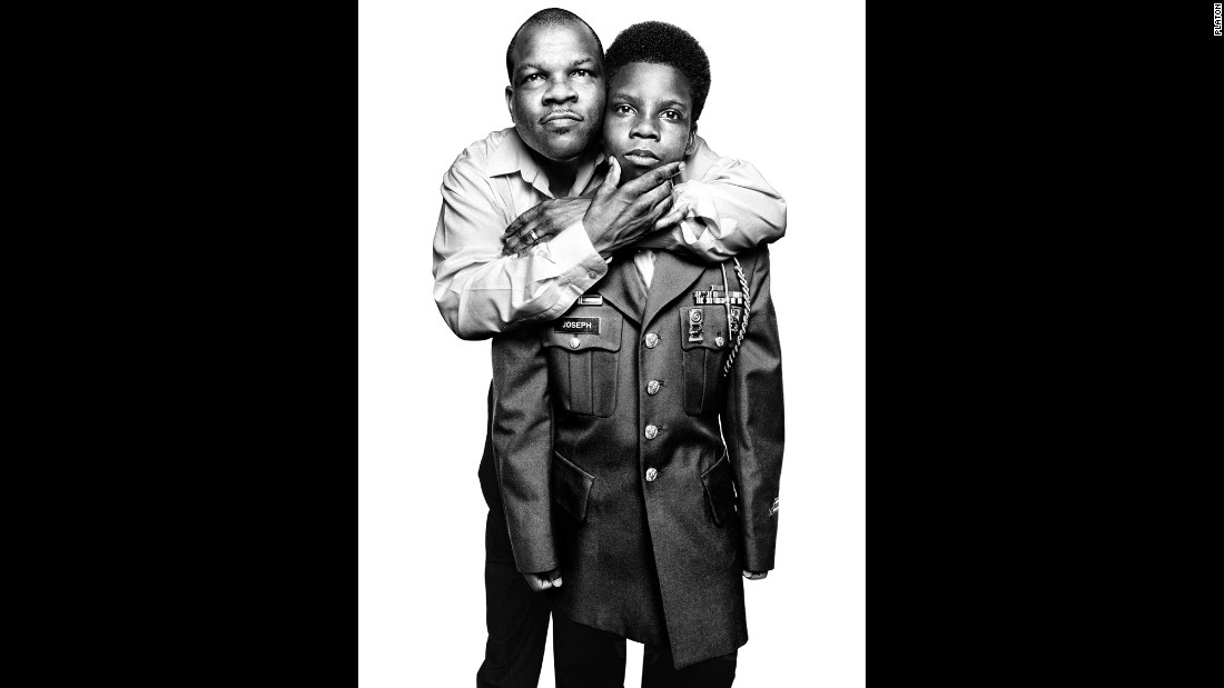 Hilarion Warren Joseph, a decorated veteran of the first Gulf War, poses with his son, Japeri. Japeri's wearing the jacket from his dad's Army uniform.