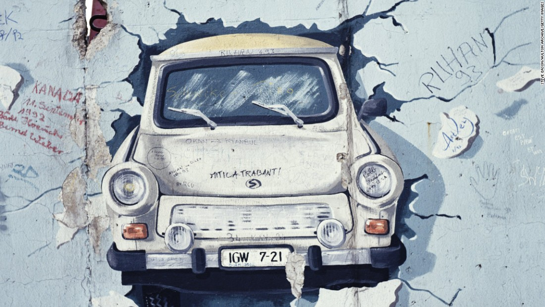A painting of a Trabant car bursting through a wall in post unification Berlin, August 1993. Formula E are hoping Saturday's race will be another breakthrough moment for electric cars.