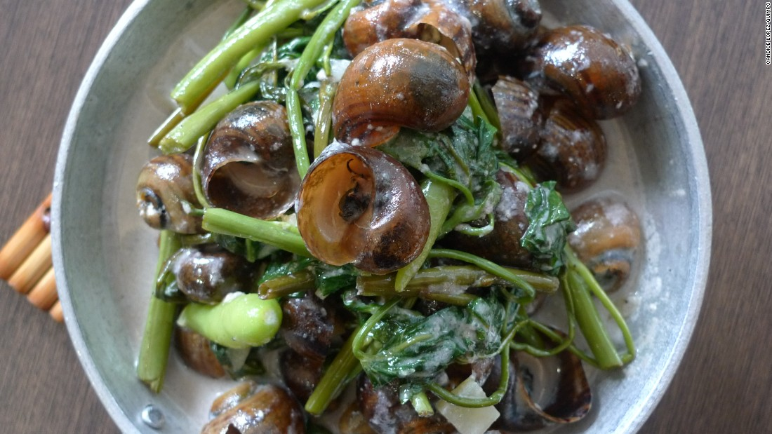 Fresh snails cooked in coconut milk and leafy vegetables are served in the shell, while a tiny fork (or toothpick) is used to loosen the meat inside.