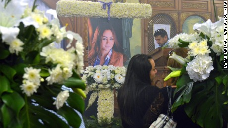 A portrait of Yara Hani Faraq Tawfiq  is seen during a memorial service.