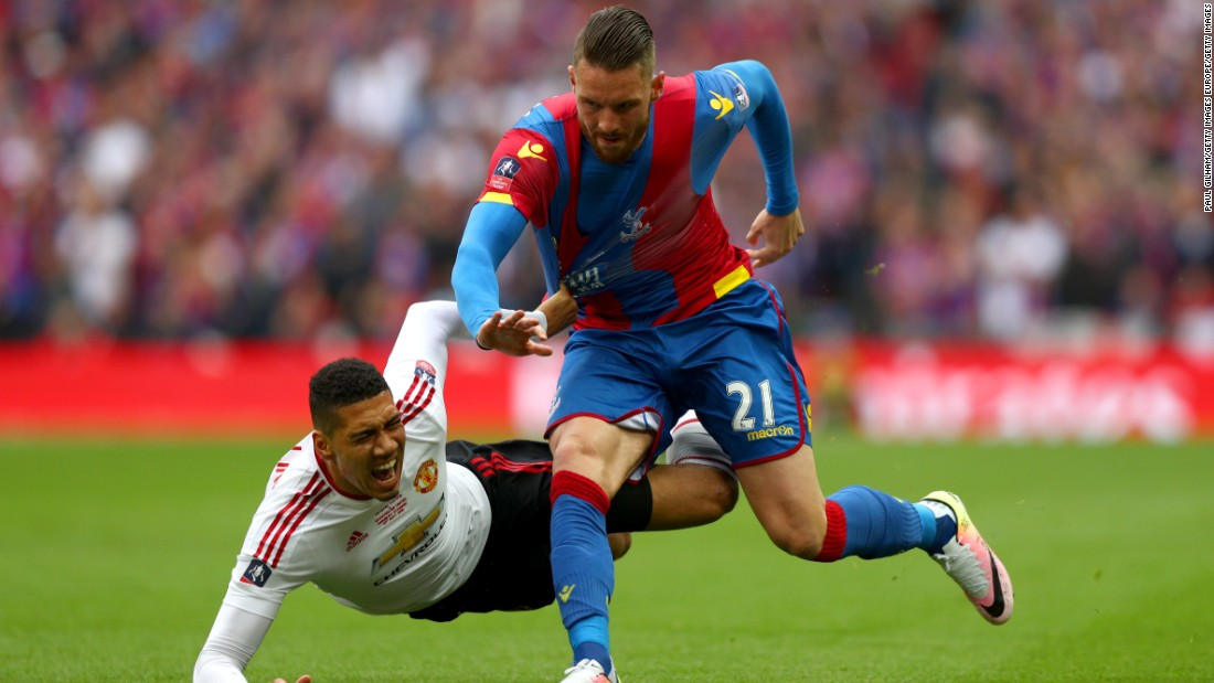 Chris Smalling was booked early on for hauling down Connor Wickham of Crystal Palace.