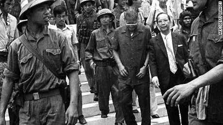 Former Vietnam President Duong Van Minh (C, looking down), leaving the presidential palace in Saigon 30 April 1975.